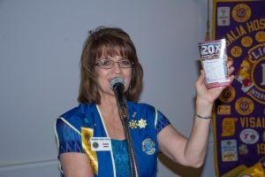 President Janet auctions off a set of Lotto Ticket's from last weeks meeting